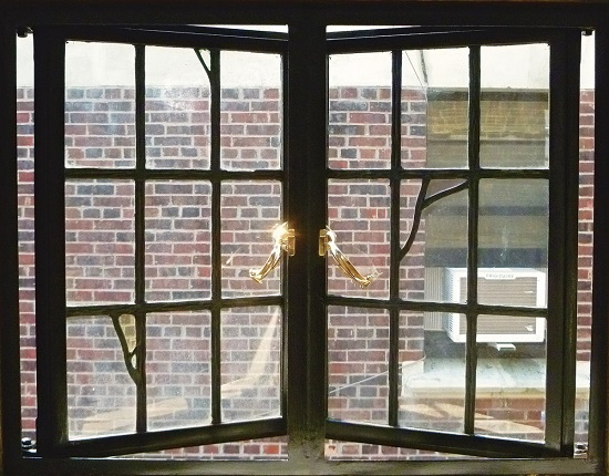 Old large metal window in a historic building